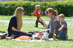 (l-r) Beth Lloyd, Sophie Gould and George Rooney enjoy a picnic in the hot spring weather in London's Regent's Park.<br /> Wednesday, 16th April 2014. Picture by Ben Stevens / i-Images