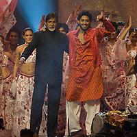 SHEFFIELD, UNITED KINGDOM - 9th June 2007: Bollywood legend Amitabh Bachchan performing on stage with son Abhishek at International Indian Film Academy Awards (IIFAs) at the Sheffield Hallam Arena on June 9, 2007 in Sheffield, England.
