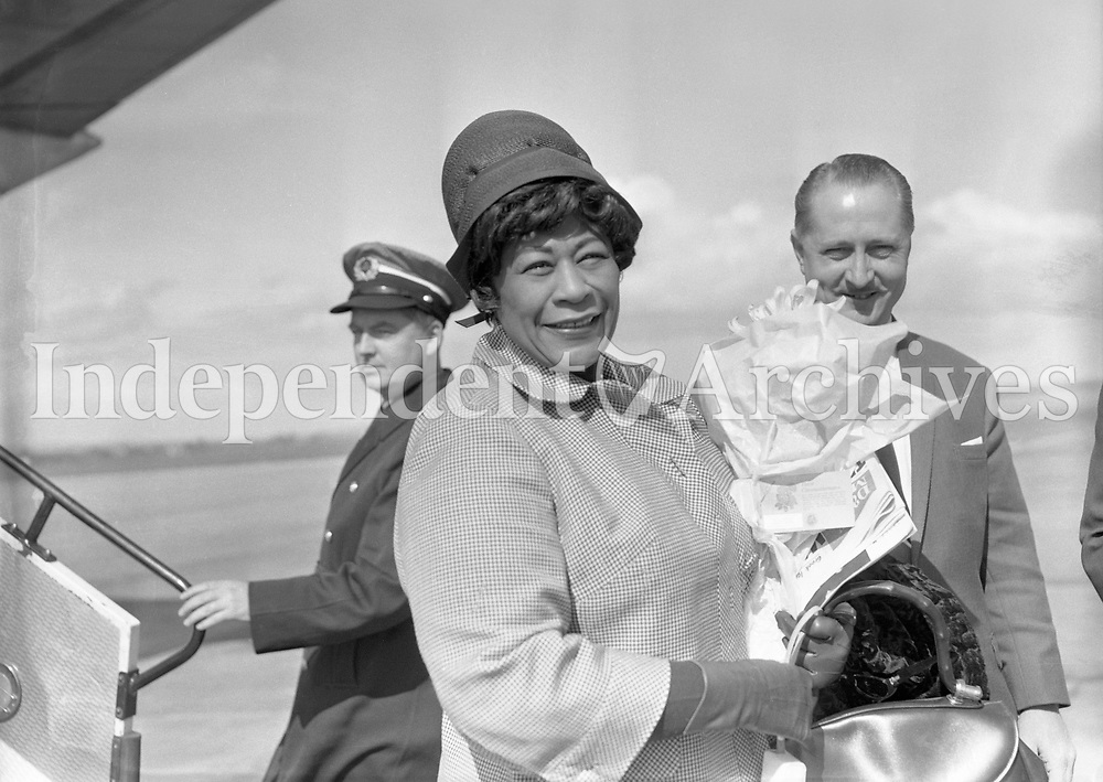 Ella Fitzgerald, the American jazz singer arriving at Dublin Airport. She was in Dublin on her first professional visit, singing at two concerts in the Adelphi Cinema. April 15th 1964. (Part of the Independent Newspapers Ireland/NLI Collection)