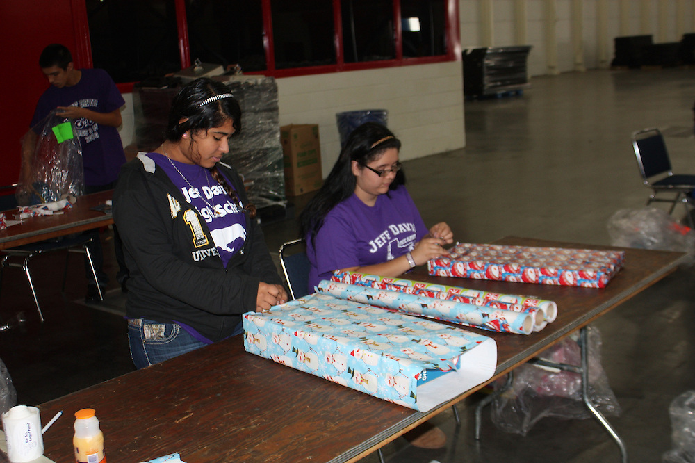 "The Davis High School JROTC helped wrap 25,000 gifts for thousands of children with disabilities from underprivileged homes. The volunteer opportunity known as ""Be An Angel"" was held at the George R. Brown Convention Center.<br />