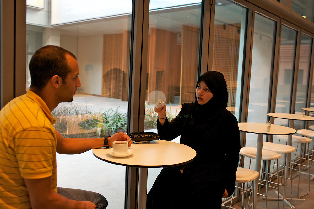 Noura (left) and Marwan, students at the Masdar Institute, discussing their work.