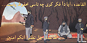 Afghanistan:  Four armed men in cave, a fifth seated on rug eating. Man at mouth of cave points to an approaching missile.  The reverse of anti-Taliban leaflet shows two men killed by the missile and the three remaining terrified.
