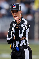 OAKLAND, CA - DECEMBER 09: NFL line judge Sarah Thomas #53 points on the field during the third quarter between the Oakland Raiders and the Pittsburgh Steelers at the Oakland Coliseum on December 9, 2018 in Oakland, California. The Oakland Raiders defeated the Pittsburgh Steelers 24-21. (Photo by Jason O. Watson/Getty Images) *** Local Caption *** Sarah Thomas