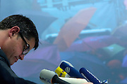 Frankfurt am Main | 03.06.2013<br /> <br /> Am Montag (03.06.2013) findet im Polizeipr&auml;sidium Frankfurt eine Pressekonferenz statt, bei der der Boris Rhein (CDU, Innenminister Hessen und Harald Schneider (Polizei Frankfurt, Einsatzleiter) versuchen, den brutalen und skandal&ouml;sen Polizeieinsatz gegen die Blockupy-Demoam Samstag (01.06.2013) zu rechtfertigen, es werden Gegenst&auml;nde gezeigt, die die Demonstranten angeblich mitgef&uuml;hrt haben, dieses werten Polizei und Innenminister als Staftaten.<br /> Hier: Boris Rhein bei der PK, im Hintergrund ein projeziertes Foto vom angeblich so gef&auml;hrlichen &quot;Schwarzen Block&quot;, der aber ganz bunt war.<br /> <br /> &copy;peter-juelich.com<br /> <br /> [No Model Release | No Property Release]