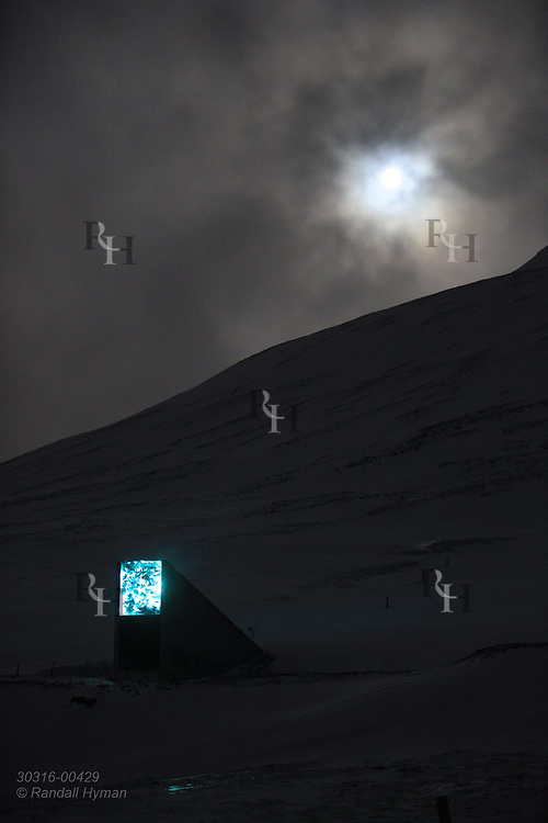 Global Seed Vault glows beneath full moon in January during the long polar night in Longyearbyen on Spitsbergen island, Svalbard, Norway.