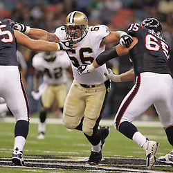 2008 August 16: New Orleans Saints defensive tackle Brian Young (66) tries to split a double-team during the first quarter of the Saints preseason match up against the Houston Texans at the Louisiana Superdome in New Orleans, LA. .