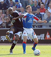 Carlisle's David Raven and Swansea's Ezomo Iriekpen.