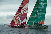CAMPER with Emirates Team New Zealand slides past Groupama. In Port Race Galway Ireland. Volvo Ocean Race 2011-2012. 7/7/2012