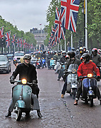 Mods riding scooters on The Mall, London, UK 2010