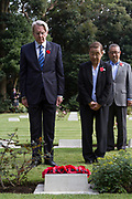 The Australian Ambassador to Japan, Richard Court (left) and the daughter of Victoria Cross recipient, Ray Simpson. lay a wreath of poppies at his grave  during the Remembrance Sunday ceremony at the Hodogaya, Commonwealth War Graves Cemetery in Hodogaya, Yokohama, Kanagawa, Japan. Sunday November 11th 2018. The Hodagaya Cemetery holds the remains of more than 1500 servicemen and women, from the Commonwealth but also from Holland and the United States, who died as prisoners of war or during the Allied occupation of Japan. Each year officials from the British and Commonwealth embassies, the British Legion and the British Chamber of Commerce honour the dead at a ceremony in this beautiful cemetery. The year 2018 marks the centenary of the end of the First World War in 1918.