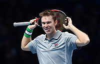 Tennis - 2018 Nitto ATP Finals at The O2 - Day Five<br /> <br /> Group Doubles Group Llodra/Santoro: Jamie Murray (GB) & Bruno Soares (Bra) vs. Henri Kontinen (Fin) & John Peers (Aus)<br /> <br /> John Peers smiles as his partner ends up off the court.<br /> <br /> COLORSPORT/ASHLEY WESTERN
