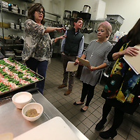 "Park Heights owner Blair Hughes, from left, gives a tour of the restaurants kitchen Thursday afternoon to this year's celebrity chefs Ruff thomas, Leslie Geoghegan and Elzabeth hamm for the annual ""Cooking Like the Stars"" fund raiser for the North Mississippi Boys and Girls Club."