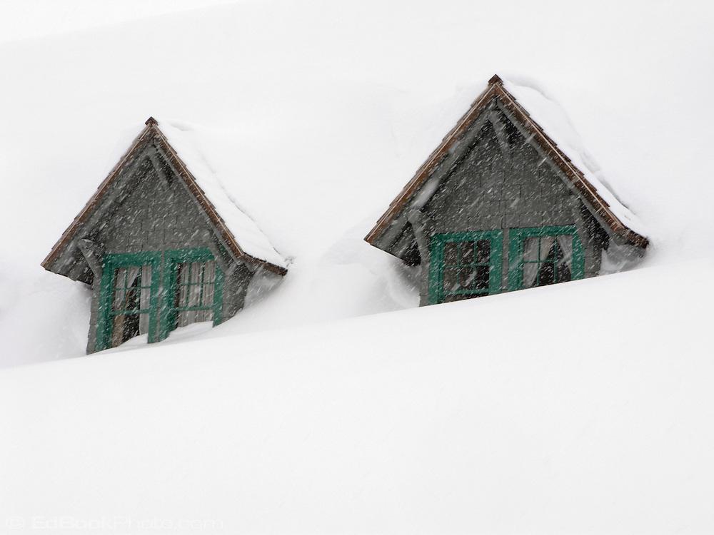 two gables of the snowed-in Paradise Inn at Mount Rainier National Park, Washington, USA gables of the snowed-in Paradise Inn during a snowstorm at Mount Rainier National Park, Washington, USA
