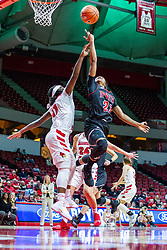 NORMAL, IL - November 20: Myia Starks tosses the ball backwards at the bucket to avoid a block from Tete Maggett during a college women's basketball game between the ISU Redbirds and the Huskies of Northern Illinois November 20 2019 at Redbird Arena in Normal, IL. (Photo by Alan Look)