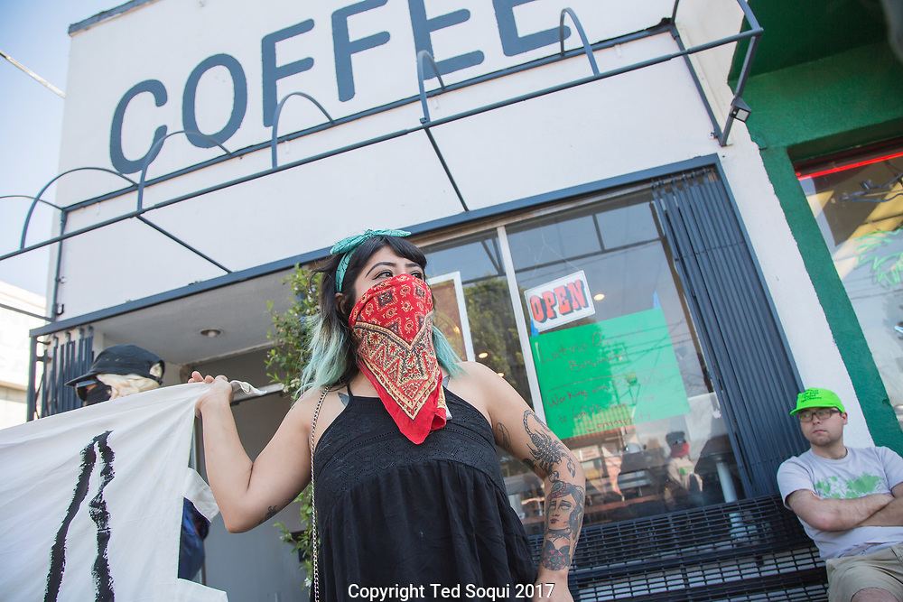 Boycott and demonstration against Weird Wave Coffee House on Caesar E. Chavez Ave in Boyle Heights. About 25 demonstrators held signs and chanted slogans out front of the coffee house.