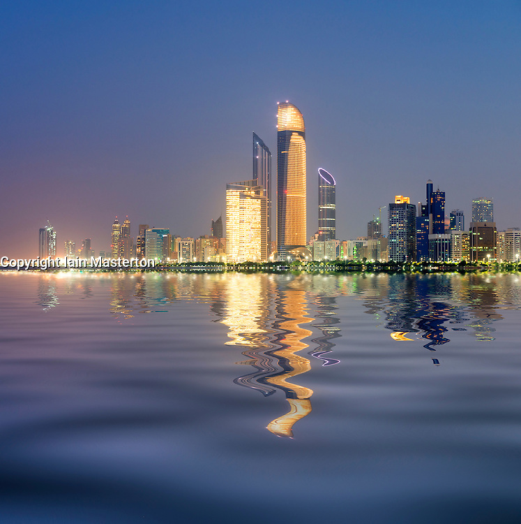 Night skyline with reflections of skyscrapers on Corniche in Abu Dhabi in United Arab Emirates UAE