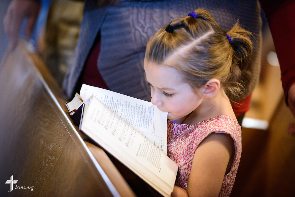 Abigail Vogt follows along in the Lutheran Service Book during worship on Transfiguration Sunday, Feb. 7, 2016, at Peace Lutheran Church in Sussex, Wis., LCMS Communications/Erik M. Lunsford