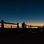 Last Light and crescent moon over Ventura, California.