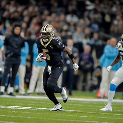 Dec 30, 2018; New Orleans, LA, USA; New Orleans Saints quarterback Teddy Bridgewater (5) runs against the Carolina Panthers during the first half at the Mercedes-Benz Superdome. Mandatory Credit: Derick E. Hingle-USA TODAY Sports
