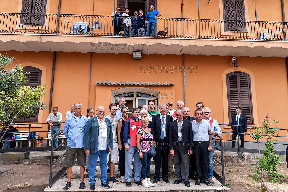 ROME, ITALY - SEPTEMBER 01: Italian PM Paolo Gentiloni with new vicar of Rome, Angelo De Donatis and the director of Caritas Rome, Msgr. Enrico Feroci pose for a photo with guests and volunteers during visit the Citadel of the Charity of the Diocesan Caritas of Rome on September 1, 2017 in Rome, Italy. Italian PM Paolo Gentiloni visited the Caritas to express the gratitude of all Italians to the world of volunteering, to those who work in favour of solidarity.
