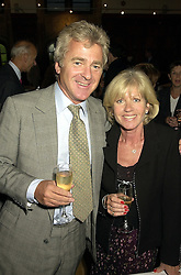 MR & MRS ROSS BENSON, he is the journalist she is Ingrid Seward editor of Majesty Magazine, at a reception in London on 13th September 2000.OGW 63