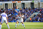 Peterborough United midfielder Mark O'Hara (8) with a header during the EFL Sky Bet League 1 match between Peterborough United and Luton Town at London Road, Peterborough, England on 18 August 2018.