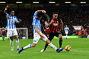 Christopher Schindler (26) of Huddersfield Town claims the ball off Callum Wilson (13) of AFC Bournemouth during the Premier League match between Bournemouth and Huddersfield Town at the Vitality Stadium, Bournemouth, England on 4 December 2018.
