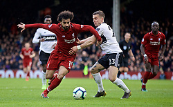 LONDON, ENGLAND - Sunday, March 17, 2019: Liverpool's Mohamed Salah (L) and Fulham's Joe Bryan during the FA Premier League match between Fulham FC and Liverpool FC at Craven Cottage. (Pic by David Rawcliffe/Propaganda)