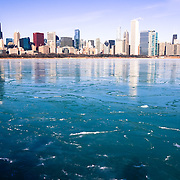 Chicago down town skyline over the frozen water of lake michigan