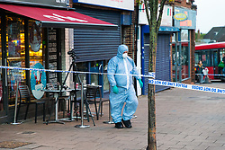 A forensics investigator is sen inside a police cordon surrounding a Costa Coffee outlet on Bowes Road in Arnos Grove following a stabbing in which a male victim has been left in critical condition. Arnos Grove, North London, November 12 2018.