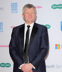 Adrian Chiles attends The Guide Dog of The Year Awards 2014 at The Hilton Park Lane Hotel, London on Wednesday 15th December 2014
