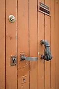 close up of an old door with handle lock mailbox and knocker