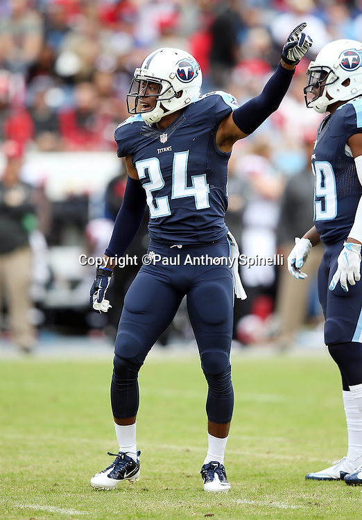 Tennessee Titans cornerback Coty Sensabaugh (24) points during the 2015 week 7 regular season NFL football game against the Atlanta Falcons on Sunday, Oct. 25, 2015 in Nashville, Tenn. The Falcons won the game 10-7. (©Paul Anthony Spinelli)