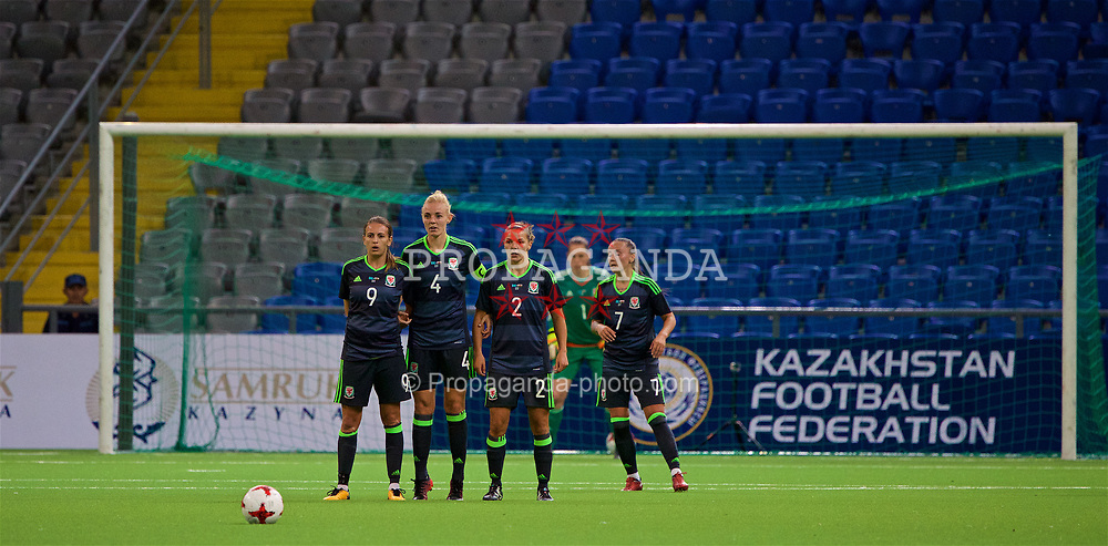 ASTANA, KAZAKHSTAN - Sunday, September 17, 2017: Wales' Kayleigh Green, captain Sophie Ingle, Loren Dykes and Natasha Harding form a defensive wall during the FIFA Women's World Cup 2019 Qualifying Round Group 1 match between Kazakhstan and Wales at the Astana Arena. (Pic by David Rawcliffe/Propaganda)