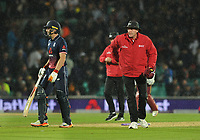 Cricket - 2017 West Indies Tour of England - Fourth One Day International (ODI): England vs. West Indies<br /> <br /> All over - The Umpire stops the game as the rain comes down and England win under the 'Duckworth  Lewis ' rule by 6 runs at The Oval.<br /> <br /> COLORSPORT/ANDREW COWIE
