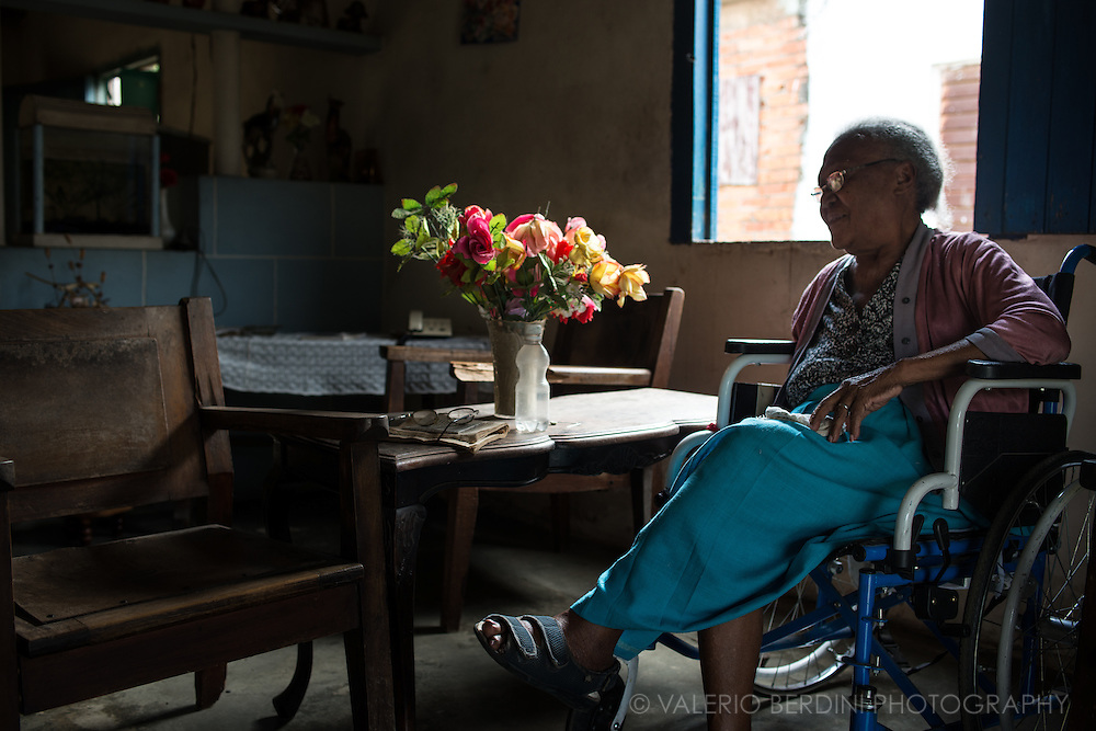 An old woman sits on a wheelchair in her home in Vinales, in the west of Cuba, taking a break from her main passion, reading books. Cuba has the highest literacy percentage in the world, its people are passionate readers.