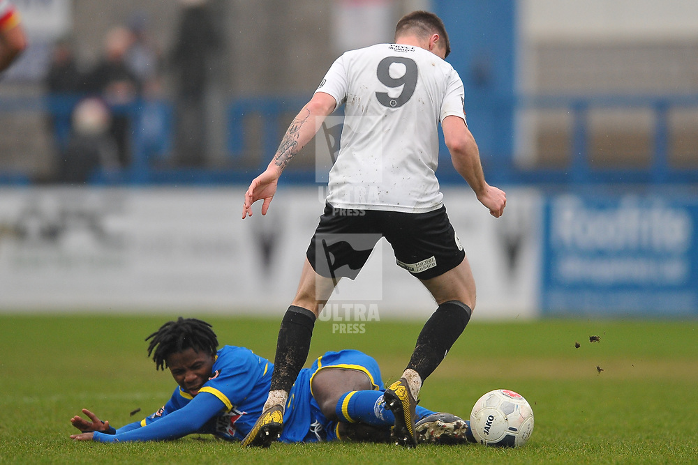 TELFORD COPYRIGHT MIKE SHERIDAN Jude Oyio tackles Matt Stenson of Telford (on loan from Solihull Moors) during the Vanarama Conference North fixture between AFC Telford United and Alfreton Town at the New Bucks Head Stadium on Thursday, December 26, 2019.<br /> <br /> Picture credit: Mike Sheridan/Ultrapress<br /> <br /> MS201920-036