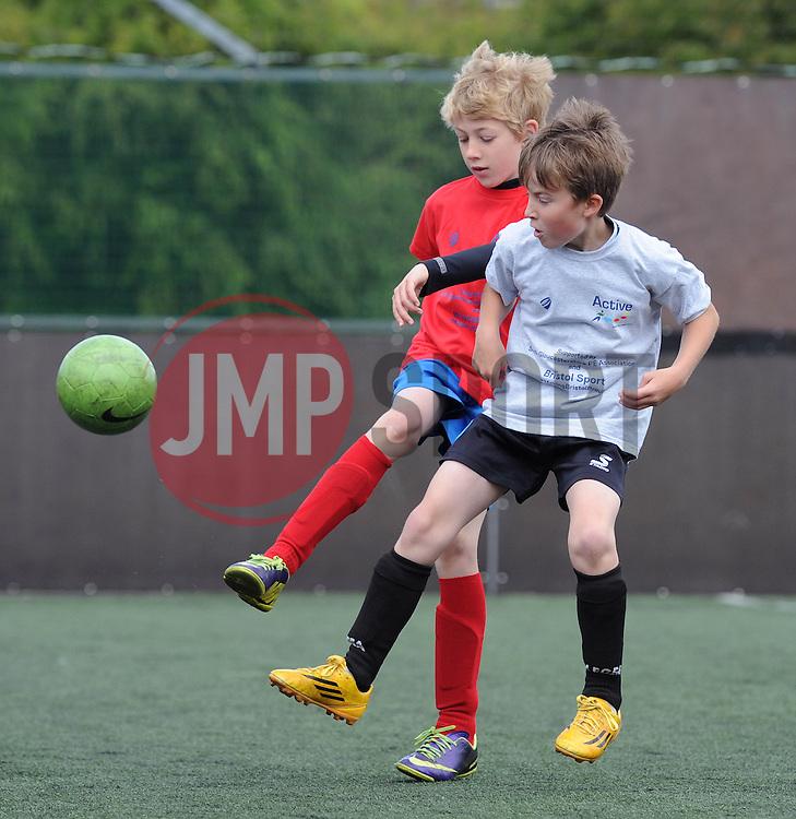 Children play football during the Bristol Sport Youth Festival - Photo mandatory by-line: Dougie Allward/JMP - Mobile: 07966 386802 - 06/06/2015 - SPORT - Multi-Sport - Bristol - SGS Wise Campus - Bristol Sport Festival Of Youth Sport - Festival Of Youth