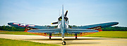 """The SBD-5 Dive Bomber on the taxiway at Falcon Field, Peachtree City, Georgia.  Photographed with the """"speed brakes"""" deployed.  Owned/operated by the Dixie Wing of the Commemorative Air Force."""