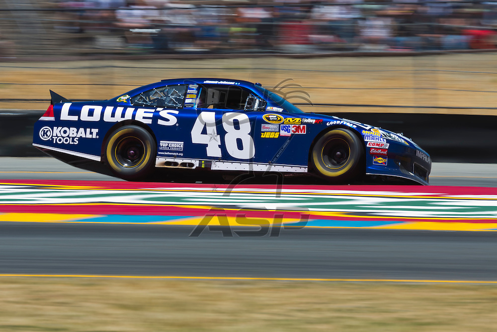 SONOMA, CA - JUN 24, 2012:  Jimmie Johnson (48) brings his car through the turns during the Toyota Save Mart 350 at the Raceway at Sonoma in Sonoma, CA.