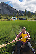 Kayaking and camping at Muncho Lake, Alaska Highway, B.C. Canada