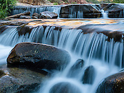 Warm morning light on the falls at Slide Rock State Park, Seonda, Arizona.