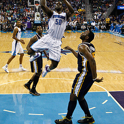 April 11, 2011; New Orleans, LA, USA; New Orleans Hornets center Emeka Okafor (50) shoots over Utah Jazz center Al Jefferson (25) during the first half at the New Orleans Arena.  Mandatory Credit: Derick E. Hingle