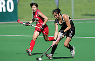 Kayla SHARLAND and Masako SATO during the BDO Women's Champions Challenge 1 match between New Zealand and Japan held at the Hartleyvale Stadium in Cape Town, South Africa on the 17 October 2009 ..Photo by RG/www.sportzpics.net.+27 21 (0) 21 785 6814
