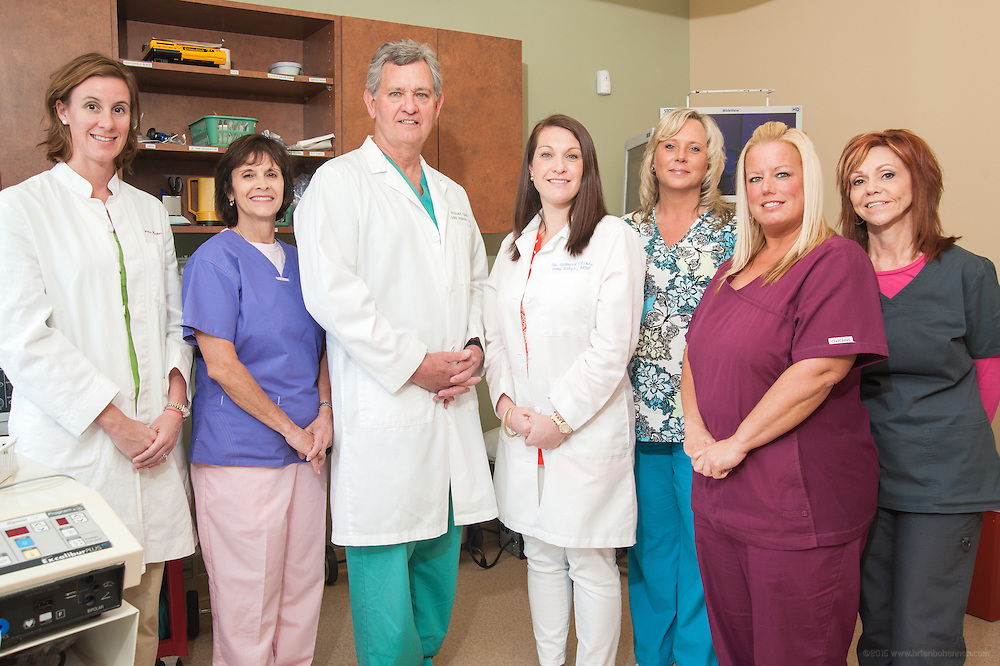 The staff at The Hubbard Clinic includes, from left: Patty P. Hooker, PA-C; Sandy Nasief, Medical Assistant; Dr. John G. Hubbard, M.D.; Emmy H. Baker, ARNP; Debbie Freeman, Administrative Assistant; Liz Fields, Surgery Coordinator and Jill Watts, Medical Assistant., photographed Thursday, May 9, 2013 in Louisville, Ky., for M.D. Update. (Photo by Brian Bohannon)