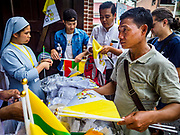 26 NOVEMBER 2017 - YANGON, MYANMAR: People at St. Mary's Cathedral buy memorabilia honoring the visit of Pope Francis to Myanmar after mass Sunday. The Pope will visit Yangon November 27 - 30. He will have private meetings  with government officials, military leaders and Buddhist clergy. He will also participate in two masses, a public mass in a sports complex on November 29 and a mass for Myanmar youth in St. Mary's Cathedral on November 30.    PHOTO BY JACK KURTZ