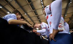 Fred Wright and Matthew Walls of Great Britain sign autographs after the medal ceremony after coming 2nd in the Men's Madsion Final during day two of the Tissot UCI Track Cycling World Cup at Lee Valley VeloPark, London.