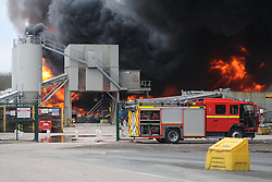 "© Licensed to London News Pictures . 15/03/2015 . Salford , UK . Fire engine at the scene . Roads are closed and people have been evacuated as a large fire burns at a unit within "" Junction Eco-Park "" in Clifton , Greater Manchester , this evening (Sunday 15th March 2015) . The smoke and flames can be seen for many miles . Forty fire fighters are at the scene working to control the blaze . Photo credit : LNP"