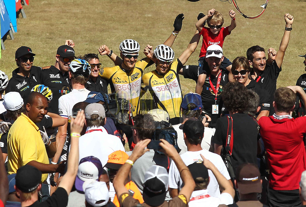 Absa Cape Epic Winners Christoph Sauser and Jaroslav Kulhavy of Burry Stander-SONGO celebrate after finishing the final stage during the final stage (stage 7) of the 2013 Absa Cape Epic Mountain Bike stage race from Stellenbosch to Lourensford Wine Estate in Somerset West, South Africa on the 24 March 2013..Photo by Shaun Roy/Cape Epic/SPORTZPICS