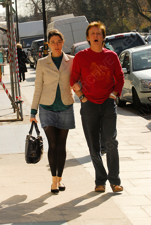 15.MARCH.2007. LONDON<br /> <br /> **EXCLUSIVE PICTURES**<br /> <br /> PAUL McCARTNEY HAS LUNCH AT CARLUCCIO'S RESTAURANT IN ST. JOHNS WOOD WITH DAUGHTER MARY, BEFORE BUYING HER A BUNCH OF FLOWERS AND WALKING HER TO THE SATION BEFORE HE WALKED BACK HOME.<br /> <br /> BYLINE: EDBIMAGEARCHIVE.CO.UK<br /> <br /> *THIS IMAGE IS STRICTLY FOR UK NEWSPAPERS AND MAGAZINES ONLY*<br /> *FOR WORLD WIDE SALES AND WEB USE PLEASE CONTACT EDBIMAGEARCHIVE - 0208 954 5968*